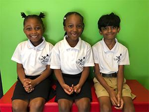 three children sitting